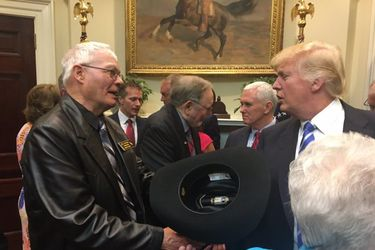 Giving the President his cowboy hat. Senator John Barrasso photo.