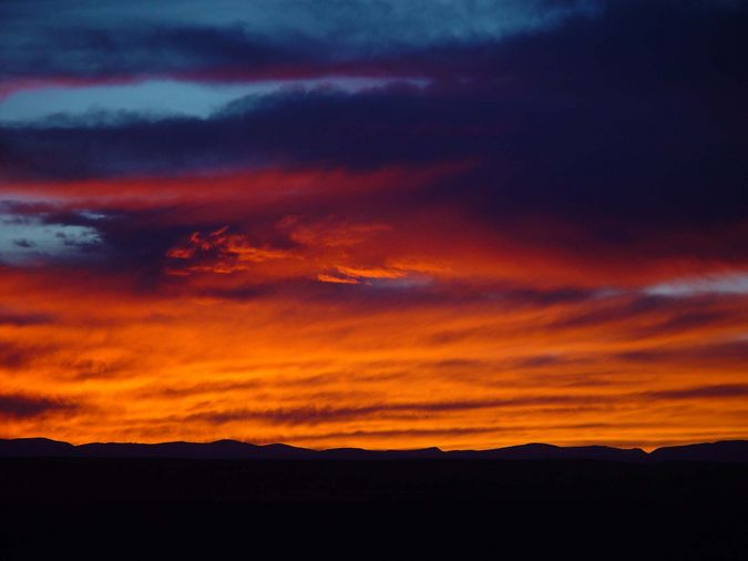 Sunset Silouettes The Wyoming Range On October 19, 2003, North Of Big Piney. Photo by Dave Bell.