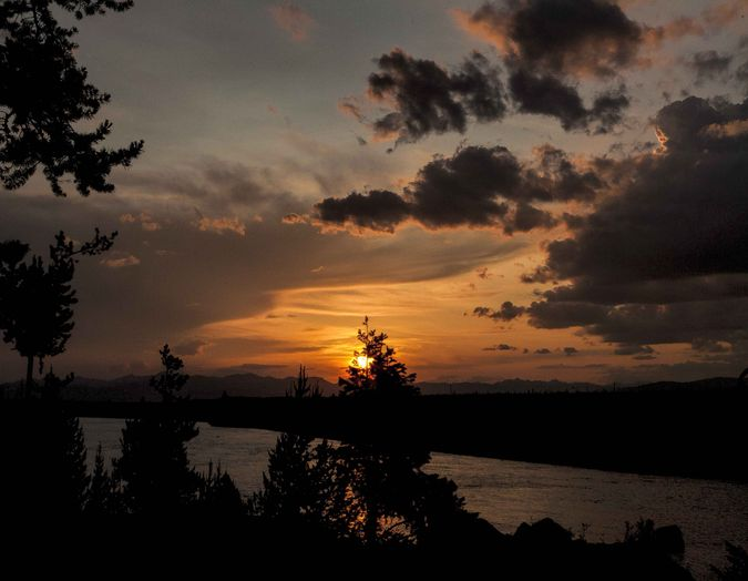 Sunset Over The Madison River--Yellowstone National Park. Photo by Dave Bell.