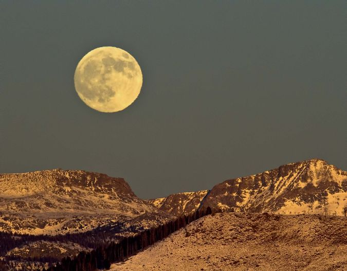 Moon Over The Mountains. Photo by Dave Bell.