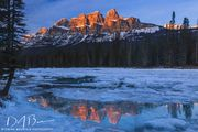 Castle Mountain Reflecting In The Bow River. Photo by Dave Bell.