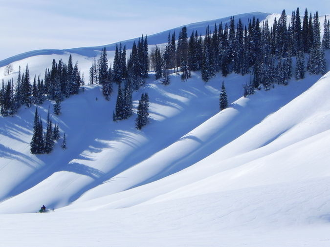 A snowmobiler in heaven at the Wyoming Range Mtns. snow dunes. Photo by Scott Almdale.