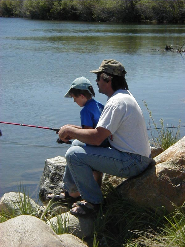 cb919f73 Dad and son fishing together. Photo by Pinedale Online.